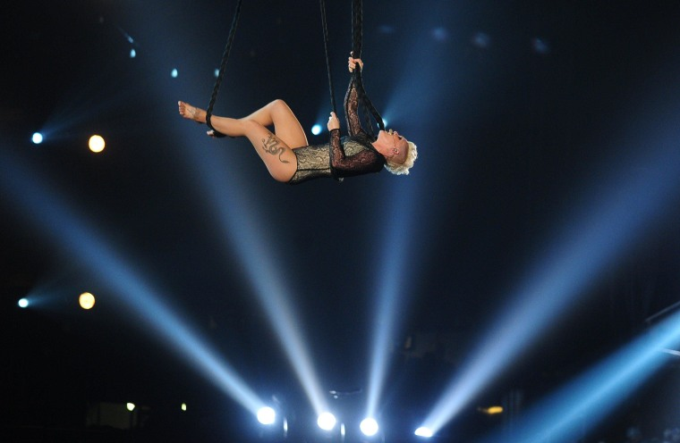 Image: Pink performs on stage for the 56th Grammy Awards