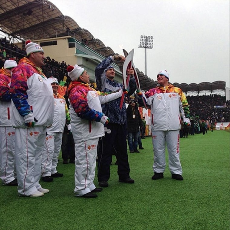 The Olympic Torch for the 2014 Sochi Games is paraded in a soccer stadium in Makhachkala, capital city of Russia's restive republic of Dagestan.
