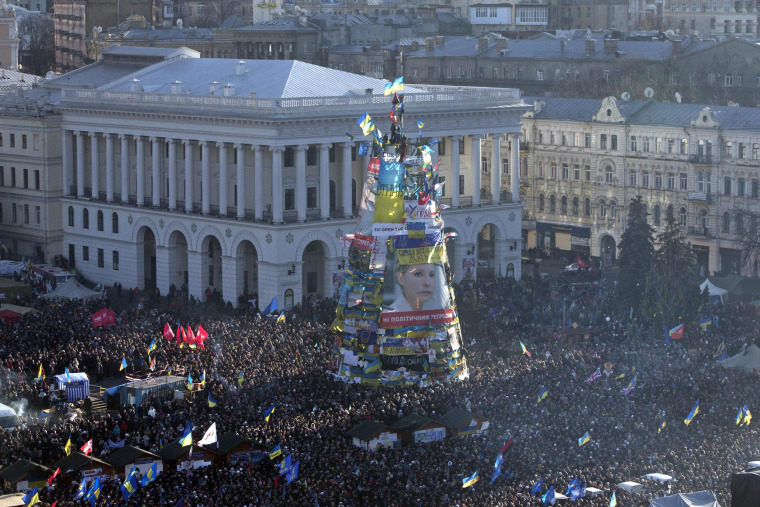 Pro-European Union activists gather during a rally in Independence Square around posters of jailed Ukrainian former Prime Minister Yulia Tymoshenko, in Kiev, Ukraine, on Dec. 22, 2013.
