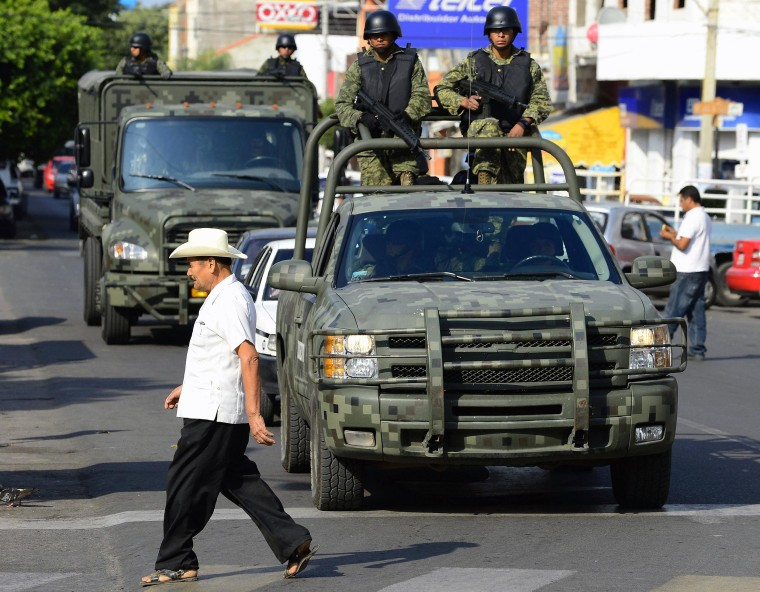 Image: Mexican soldiers patrol the streets of Apatzingan, in Michoacan State, Mexico, on Jan. 16.