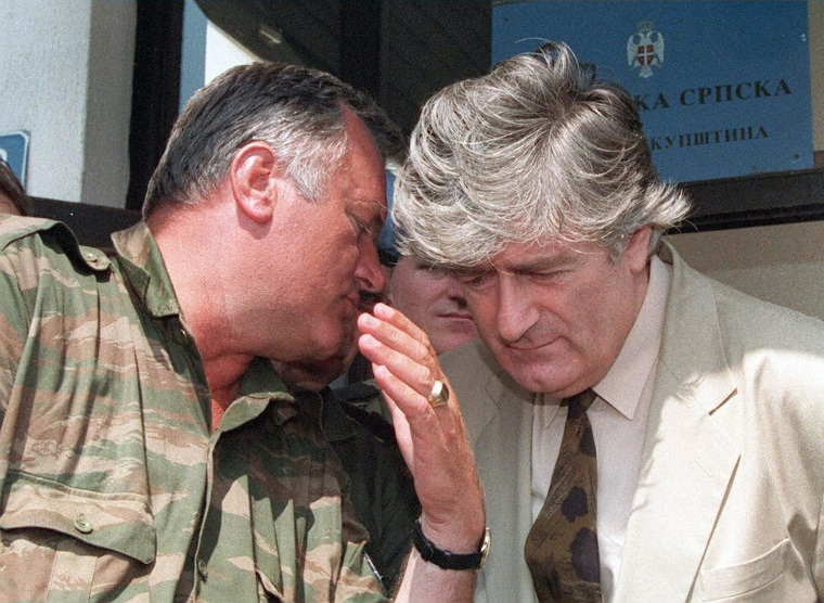 "This picture taken on Aug. 5, 1993 shows Bosnian Serb leader Radovan Karadzic, right, listening to Bosnian Serb Commander Ratko Mladic during a meeting with the press in Pale. Former Bosnian Serb army leader Ratko Mladic on January 28, 2014 refused to testify at the trial of political counterpart Radovan Karadzic, despite a subpoena issued by the Yugoslav war crimes court.   ""I do not want to testify and refuse to testify for reasons of my health and that it would prejudice my own case,"" Mladic told the International Criminal Tribunal for the former Yugoslavia (ICTY), which he had previously labelled as ""satanic"". 