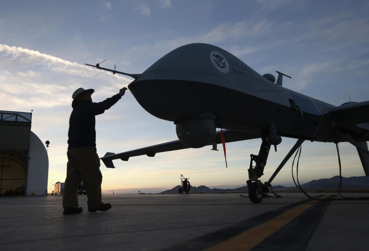 Maintenance personnel check a Predator drone operated by U.S. Office of Air and Marine (OAM), before its surveillance flight near the Mexican border.