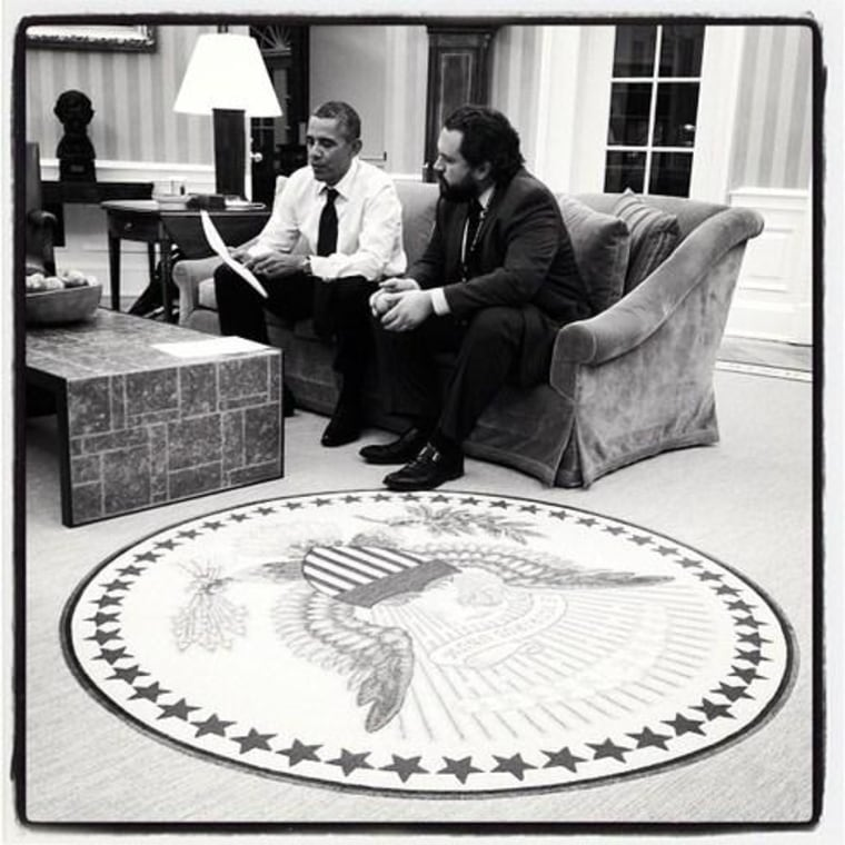 President Obama confers with an aide on his State of the Union Speech