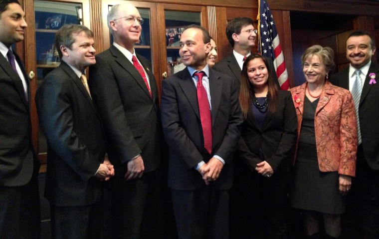 Members of the Illinois congressional delegation with invited immigrant guests for the State of the Union.