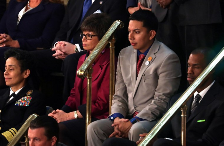 Image: Mi Familia Vota's Cristian Avila (C) sits with Senior Advisor to the President of the United States Valerie Jarrett