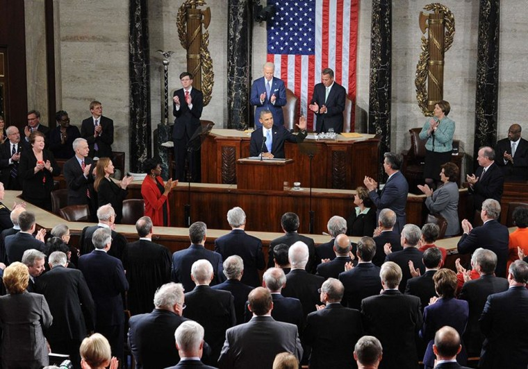 Image: Barack Obama receives a standing ovation before delivering his State of the Union address