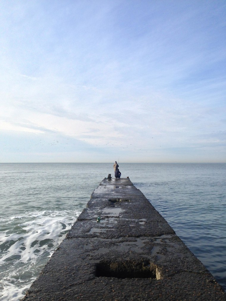 Image: A man fishes in the morning light on the Black Sea in Sochi, Russia.