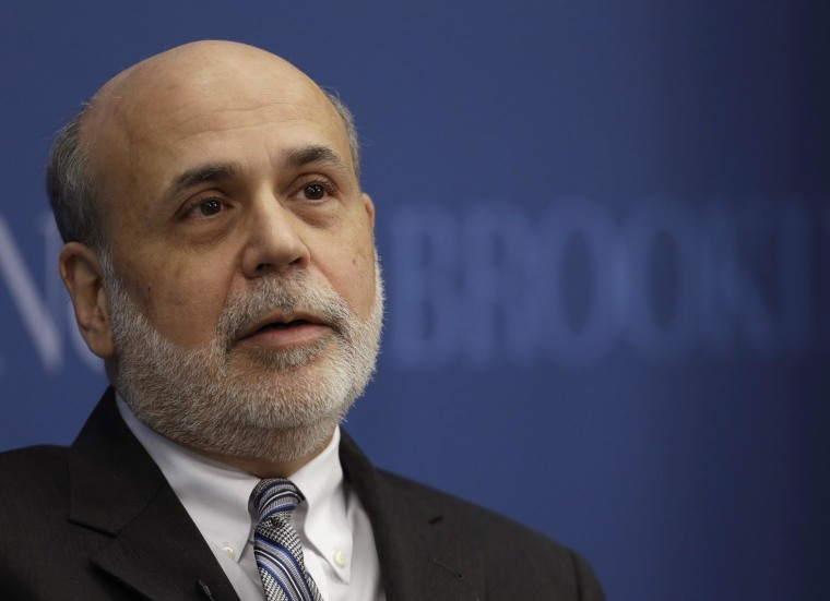 The Federal Reserve, with chairman Ben Bernanke at the helm for the last time, trimmed its economic stimulus program on Wednesday by $10 billion to $65 billion.