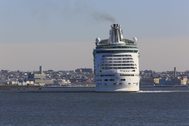 Image: The Explorer of the Seas cruise ship returns to port after hundreds of passengers became ill.