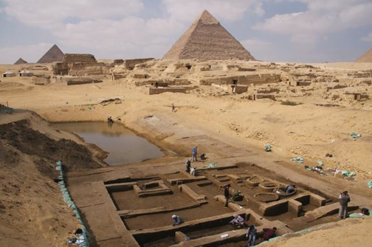 """Near the Giza Pyramid archaeologists have discovered a basin that may have been part of a thriving harbor and a """"silo building complex,"""" suggesting royal cult priests occupied the complex."""