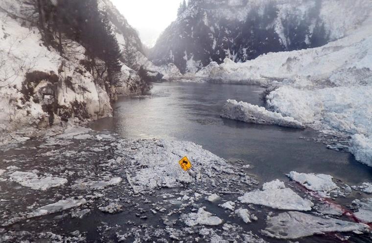 Image: A lone highway sign rises above the closed Richardson Highway near Valdez, Alaska.