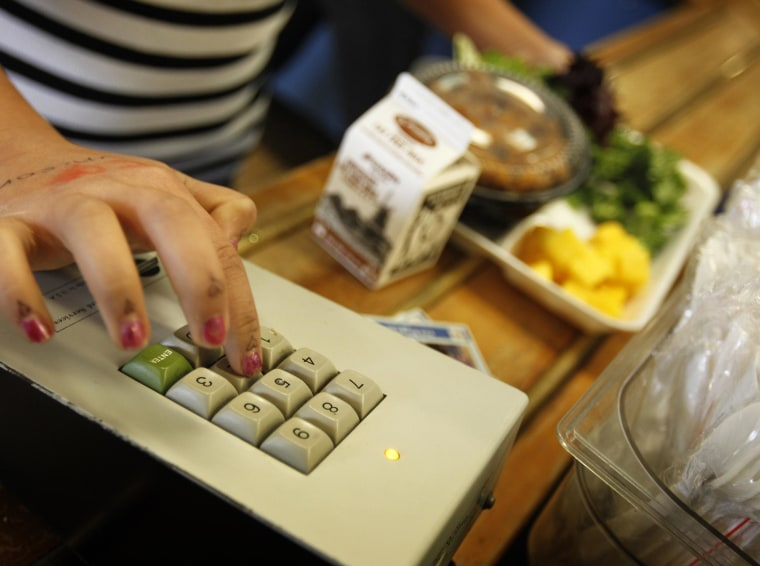 A student keys in her payment code as she orders a healthy school lunch.