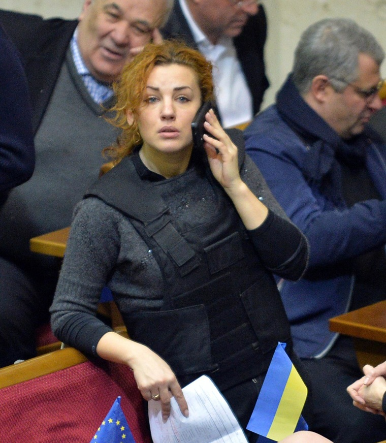 Image: Lesya Orobets wears a bulletproof vest during an extraordinary session of the Ukrainian parliament