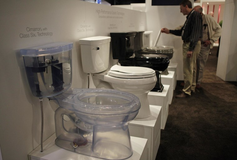 Show attendees look at toilets at the International Builders Show in Las Vegas in 2009.