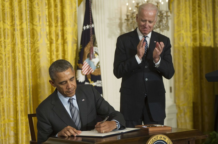 Vice President Joe Biden applauds as US President Barack Obama signs a memorandum directing Federal Government not to discriminate against long-term unemployed job seekers at the White House on Friday.