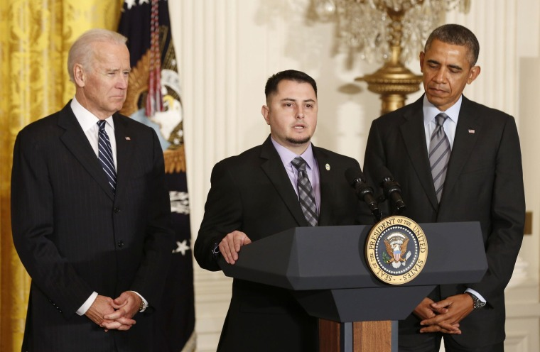 Image: U.S. President Obama and Vice President Biden listen to apprentice electrician Varela of Pacific Gas and Electric discuss his previous unemployment , in East Room of White House in Washington