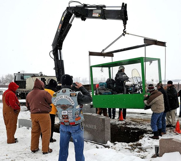Billy Standley of Mechanicsburg, Ohio started planning to be buried on his 1967 Harley Davidson motorcycle about 18 years ago. His family carried out his wish Friday with a large Plexiglas casket at Fairview Cemetery in Mutual, Ohio.