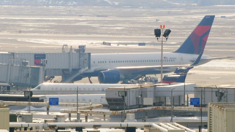 Delta Flight 987 sits at the gate at Philadelphia International Airport on Saturday.