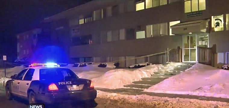 Police at the scene of a shooting near Michigan State University.