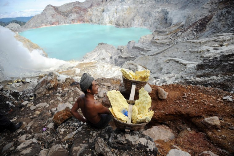 Image: A miner carrying blocks of sulfur