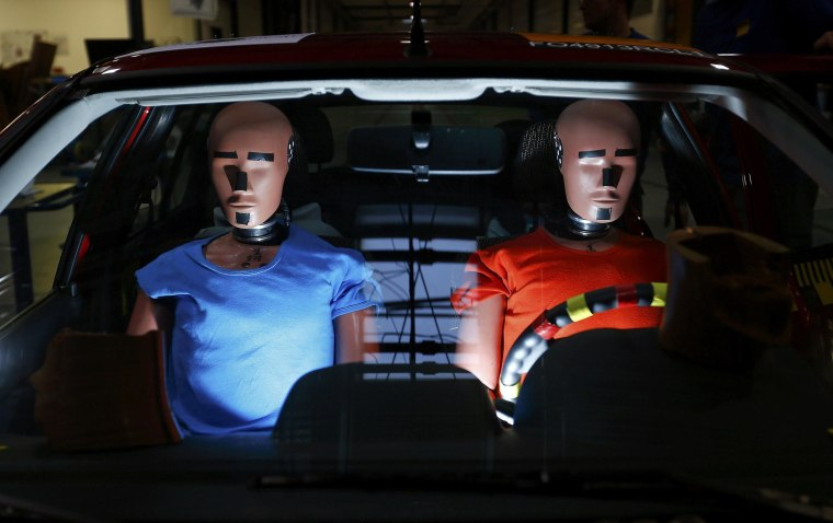 Dummies are prepared for a car crash-test at the laboratory of the German motor club ADAC in Landsberg December 5, 2013. The ADAC has a crash test facility accredited by Euro NCAP (New Car Assessment Programme) where it runs various tests probing new cars for safety under different scenarios, pedestrian protection and other automotive tests. The results about the safety of popular car models are freely available to readers on ADAC web site.