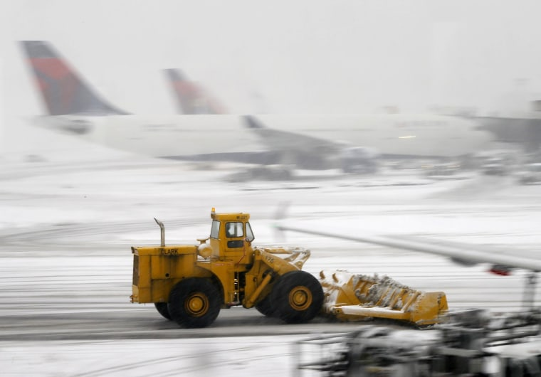 Image: A snowplow clears the runway at Newark Liberty International Airport in Newark, N.J.