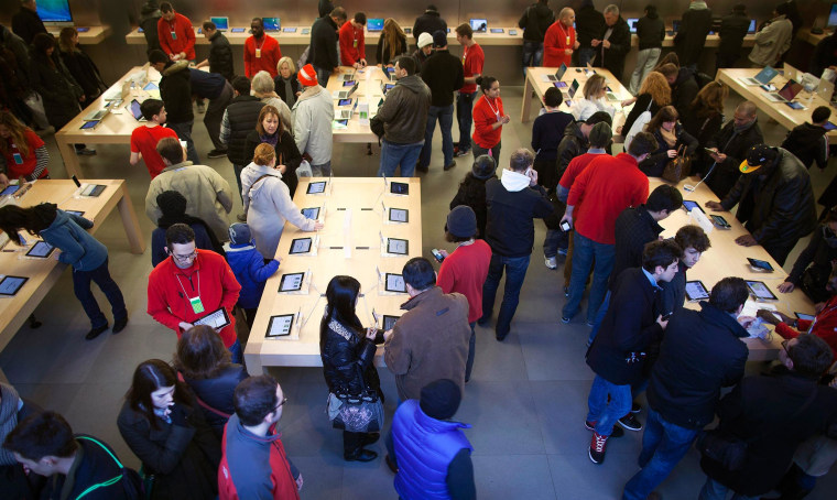Image: Shoppers are pictured inside an Apple store on 5th Ave during Black Friday Sales in New York