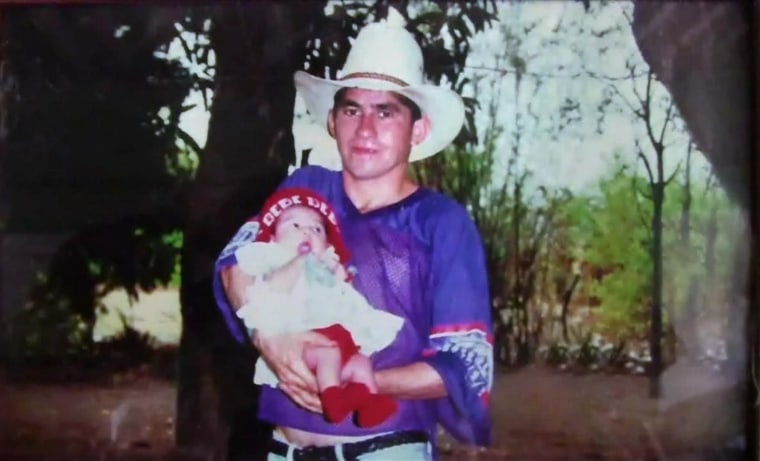 Image: Jose Salvador Alvarenga the castaway holding his daughter, Fatima Maeva Alvarenga, in El Salvador, when she was a baby.