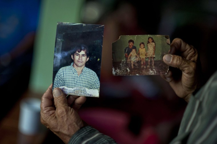 The father of Salvadorean castaway Jose Salvador Alvarenga, Jose Ricardo Orellana, shows pictures of his son, at his house in Garita Palmera, 102 km west of San Salvador on February 4, 2014. Alvarenga claims to have survived 13 months adrift in the Pacific before washing ashore in the Marshall Islands after going on a fishing trip in December 2012 with a teenager who died while they were lost at sea. Alvarenga, who was found at a remote coral atoll last Thursday, was recuperating in a hospital in the Marshall Islands.