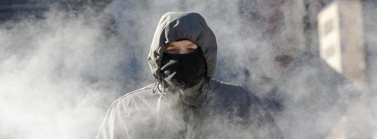 Image: A man walks through a steam cloud in frigid cold temperatures in Manhattan, New York.
