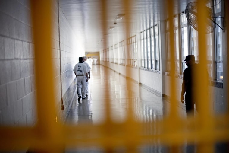 Image: Prisoners move through the state prison in Jackson, Ga.