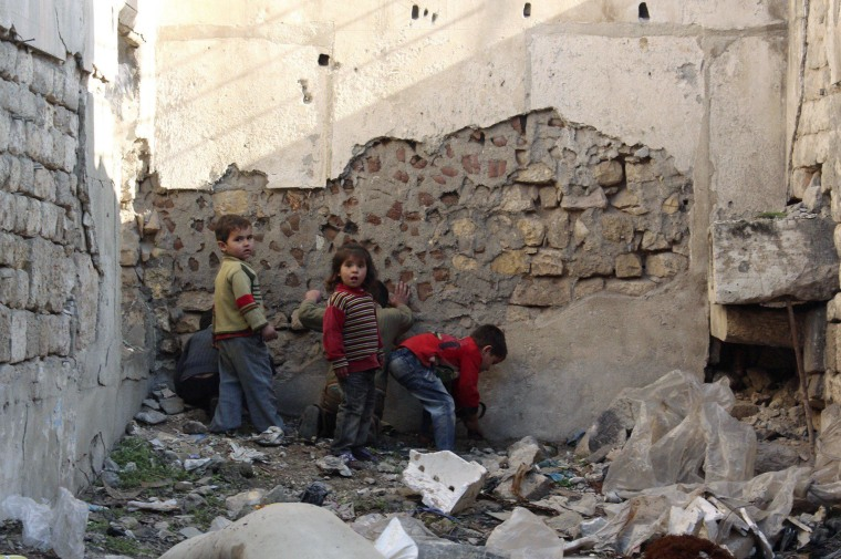 Image: Children play in the old city of Aleppo