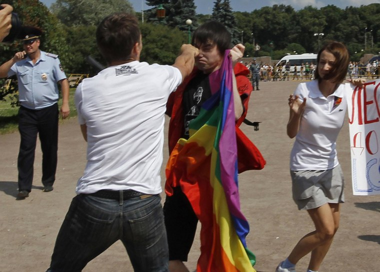 An anti-gay protester clashes with a gay rights activist during a Gay Pride event in St. Petersburg