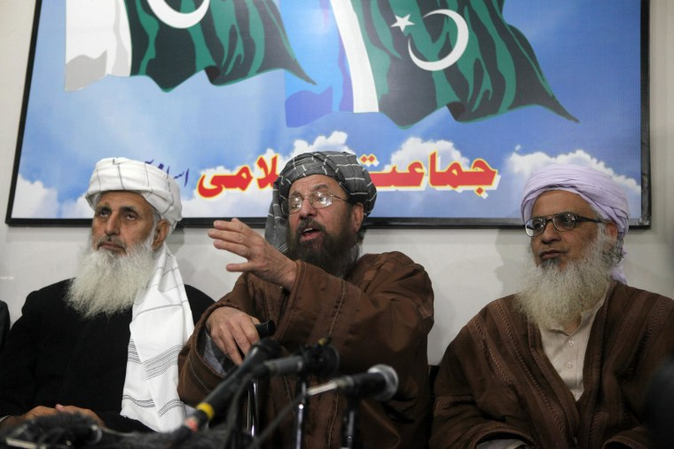 Maulana Sami ul-Haq, center, a Taliban negotiator, speaks during a news conference with his team members Ibrahim Khan, left, and Maulana Abdul Aziz in Islamabad on Tuesday.