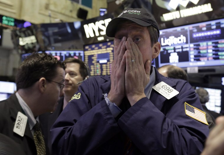 Trader Luke Scanlon works on the floor of the New York Stock Exchange on Wednesday. Stocks edged lower in early trading.