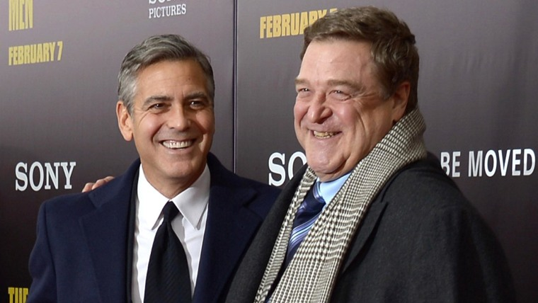 "NEW YORK, NY - FEBRUARY 04:  Filmmaker George Clooney (L) and actor John Goodman attend the ""Monument Men"" premiere at Ziegfeld Theater on February 4, 2014 in New York City, New York.  (Photo by Michael Loccisano/Getty Images)"