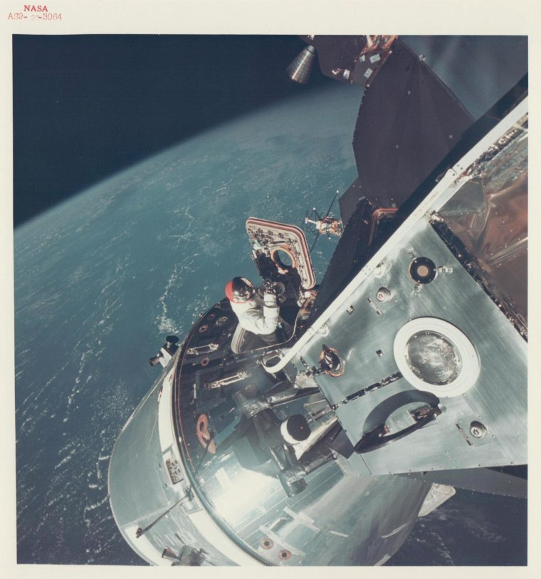 David Scott climbs through the open hatch of the Command Module, Apollo 9, March 1969.