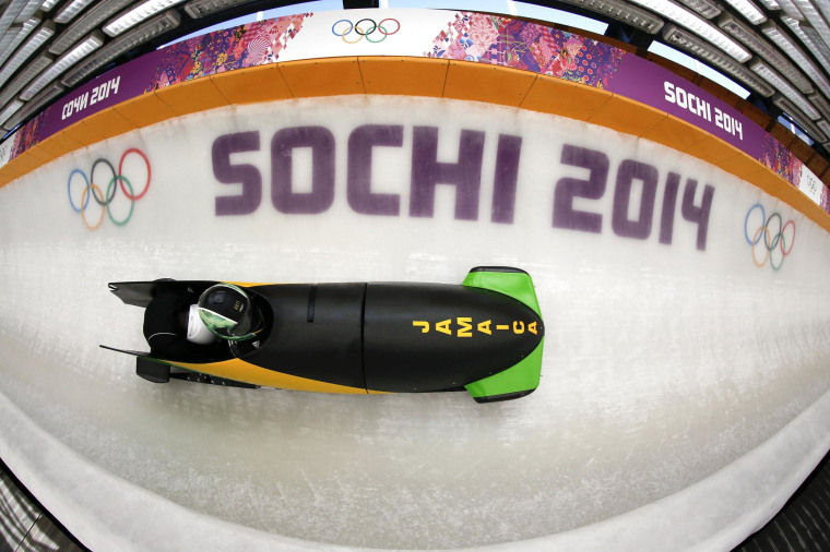 Jamaica's two-man bobsleigh pilot Winston Watts speeds down the track during an unofficial progressive training at the Sanki sliding center in Rosa Khutor, a venue for the Sochi 2014 Winter Olympics on Feb. 6.