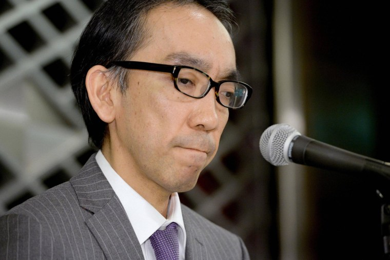 Image: Takashi Niigaki, a part-time university professor, attends a news conference in Tokyo