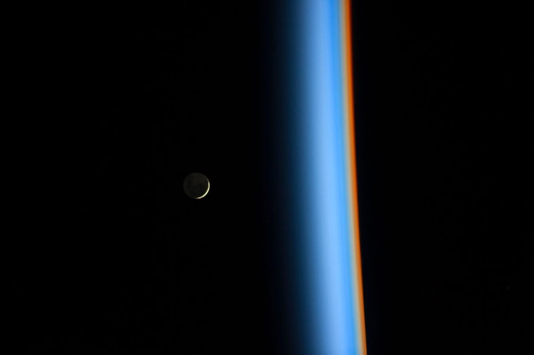 A crescent moon rises over the cusp of the Earth's atmosphere in this picture by Japan Aerospace Exploration Agency astronaut Koichi Wakata onboard the International Space Station taken February 1, 2014. 