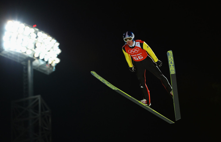 Image: Severin Freund of Germany jumps during the Men's Normal Hill Individual Ski Jumping training