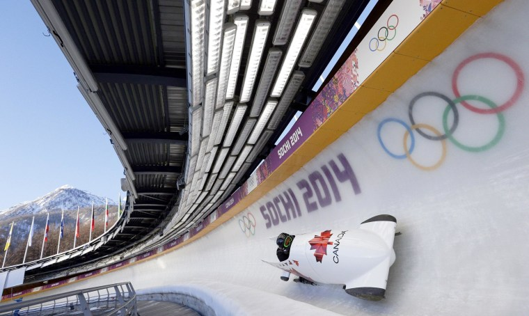 Image: The CAN-2 sled from Canada takes a turn during a training run for the two-man bobsled at the 2014 Winter Olympics on Feb. 6 in Krasnaya Polyana, Russia.