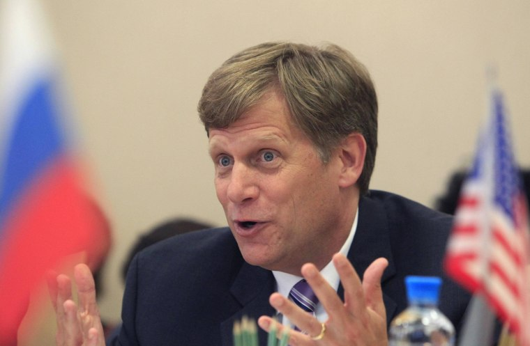U.S. Ambassador to Russia Michael McFaul gestures during his meeting with deputies of the United Russia party at Russia's State Duma, lower house of parliament, in Moscow, in this May 25, 2012 file photo.
