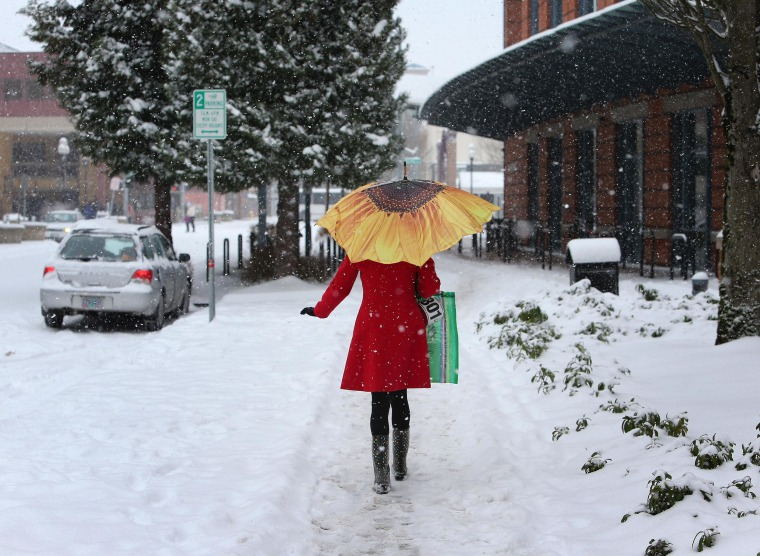Snow Slams Northwest As Power Outages Plague East