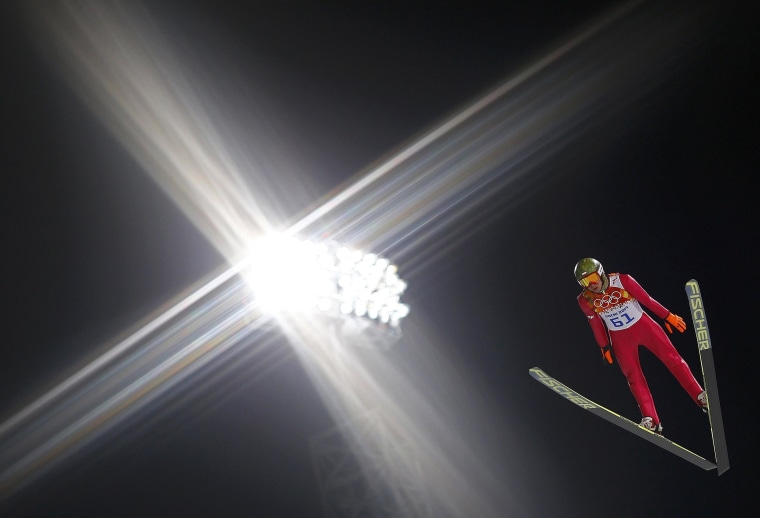 Image: Poland's Stoch soars through the air during his trial jump in the men's ski jumping individual normal hill qualification round event of the Sochi 2014 Winter Olympic Games in Rosa Khutor