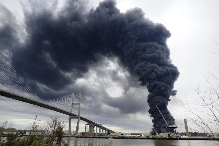 Image: Firefighters battle a blaze in a warehouse at the Georgia Ports Authority Ocean Terminal