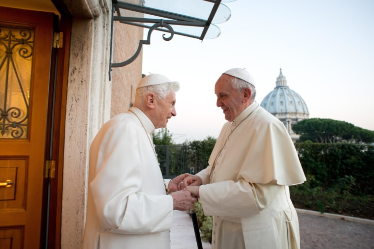 This handout picture released on December 23, 2013 by the Vatican press office shows Pope Francis (R) meeting with Pope Emeritus Benedict XVI at the Mater Ecclesiae monastery at the Vatican.