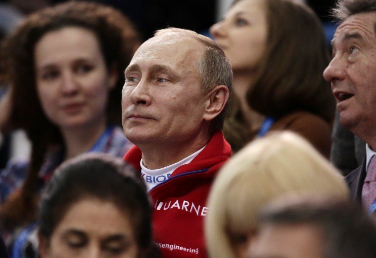 Russian President Vladimir Putin attends the figure skating competition at the Iceberg Skating Palace during the 2014 Winter Olympics, Sunday, Feb. 9, 2014, in Sochi, Russia.