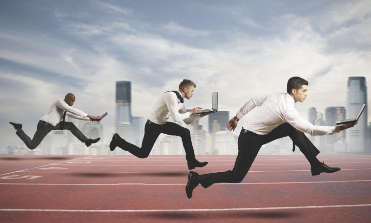 Competition in business concept with running businesspeople