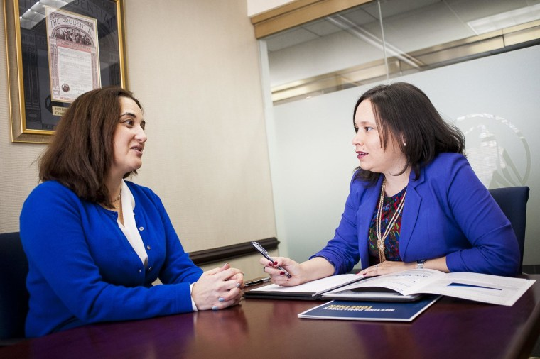Sylvia Tergas, a financial planner with Prudential Mid-Atlantic Financial Group, discusses investment strategy with her client Julie Diaz-Asper, owner of Social Lens Research.